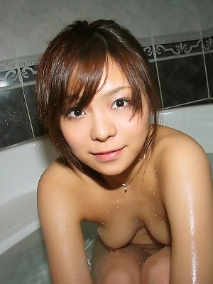 Japanese slut gets a hard cock in her vagina doggy style by her naughty friend