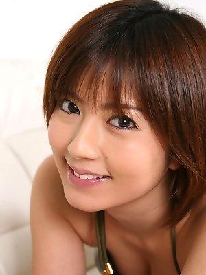 Kaori Tanaka Asian shows juicy boobies in shinny bra in her bed