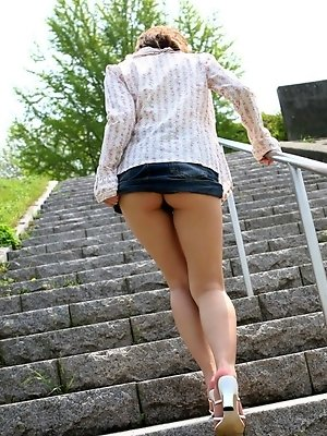 Hitomi is a naughty Asian model who uses her hot ass and big tits a lot