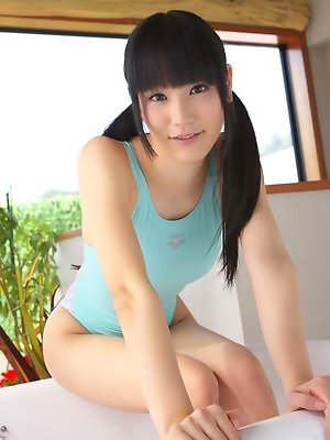 Yuri Hamada Asian in blue bath suit enters to play in bathtub