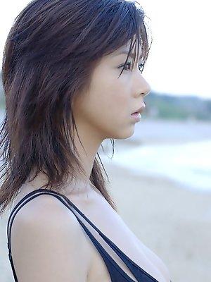 Gravure idol with plump petite breasts having fun at the beach